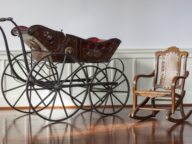Renaissance Revival Style Carriage, walnut with velvet upholstery, late 19th century. Wooden, folding child's rocker, late 19th century.